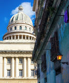 The capitol of Havana and a crumbling building — Stock Photo