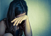 Lonely girl crying with a hand covering her face — Foto Stock
