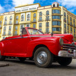 Stock Photo: Vintage red Ford parked near hotel in Havana