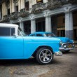 Vintage Chrysler next to old buildings in Havana — Stock Photo #17647879