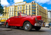 Vintage red Ford parked near a hotel in Havana — Stock Photo
