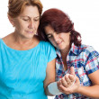 Elderly woman with a broken arm and her caregiver - Stockfoto