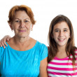 Portrait of an hispanic grandmother and granddaughter - Stock Photo