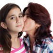 Hispanic mother kissing her beautiful daughter — Stock Photo