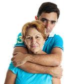 Homem hispânico, abraçando sua mãe — Foto Stock