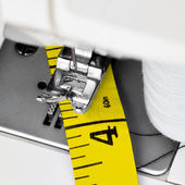 Sewing machine and yellow measuring tape — Stock Photo