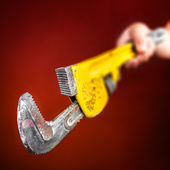 Hand holding a monkey wrench — Stock Photo