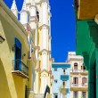 Stock Photo: Colorful street in Old Havanwith Church of Angel
