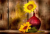 Sunflowers with and old wood planks background — Stock Photo