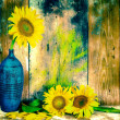 Vintage image of sunflowers and pottery vases — Stock Photo