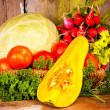 Fresh and colorful vegetables on a basket — Stock Photo