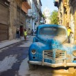 Street scene with an old rusty american car in Havana — Stock Photo #23485211