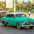 Постер, плакат: Old Chevrolet used as a taxi in Havana
