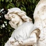 Beautiful ancient female angel sculpture — Stock Photo #23754685