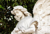 Beautiful ancient female angel sculpture — Stock Photo