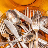 Cutlery and dishware washed under a water stream — Stock Photo