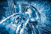 Blue toned image of metallic silverware washed — Stock Photo