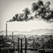 Huge smoke colums from an oil refinery — Stock Photo