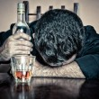 Drunk man sleeping with his head on a table — Stock Photo
