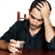 Hispanic man holding an alcoholic drink and suffering a headache — Foto Stock