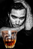 Black and white grunge portrait of a drunk and depressed hispani — Stock Photo