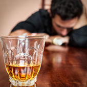 Drunk asleep man addicted to alcohol — Stock Photo
