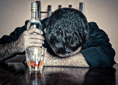 Drunk man sleeping with his head on a table — Stok fotoğraf