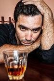 Drunk and depressed hispanic man — Stock Photo