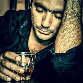 Portrait of a lonely and desperate drunk hispanic man — Stock Photo