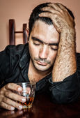 Lonely and desperate drunk hispanic man — Stock Photo