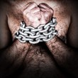 Shirtless man with his hands chained — Stock Photo