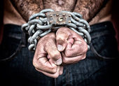 Detail of the chained hands of an adult man — Stock Photo