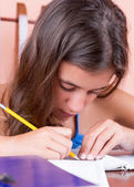 Latin teen working on her school project — Stock Photo