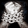 Hands locked by a strong chain — Stock Photo