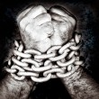 Stock Photo: Hands locked by strong chain