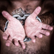 Stock Photo: Chained hands asking for freedom