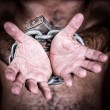 Chained hands asking for freedom — Stock Photo
