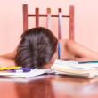 Exhausted student sleeping with her head on a table — Stock Photo #26620115