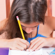 Hispanic girl working on her school project — Stok fotoğraf