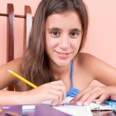 Beautiful hispanic girl studying at home — Stock Photo