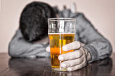 Black and white image of a sleeping drunk man — Stock Photo
