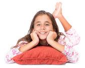 Girl laying on the floor wearing her pajamas — Stock Photo