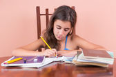 Hispanic girl working on her school homework — Stock Photo