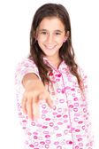 Girl wearing pajamas and pointing a finger at the camera — Stock Photo
