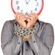Man holding a clock in place of his face with his hands chained — Stock Photo #26724807