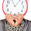 Man holding a clock in place of his face with his hands chained — Stock Photo #26724943