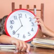 Tired child sleeping and holding a clock — Foto de Stock