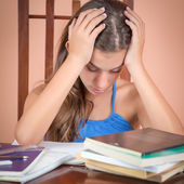 Hispanic student exhausted after studying too much — Stock Photo