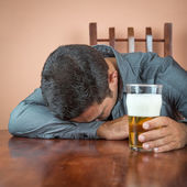 Drunk man sleeping on a table — Stock Photo