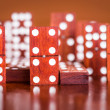 Dominoes with out of focus pieces in the back — Stock Photo #27128539